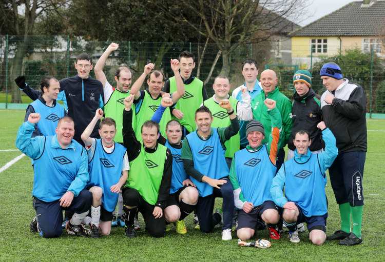 19/12/14***NO REPRO FEE***Irish captain Robbie Keane and his wife Claudine attended a training session for Special Olympic football athletes at Crumlin United FC's grounds yesterday. The football star took part in a training session with the 11-a-side men's football team who will be heading to the 2015 Special Olympics World Summer Games in Los Angeles next July. The LA Galaxy striker and his wife are both ambassador's for Team Ireland and are fronting the Support An Athlete campaign which is aiming to raise the necessary €440,000 required to cover the cost of sending 88 Irish athletes to the Games.  Pic: Marc O'Sullivan